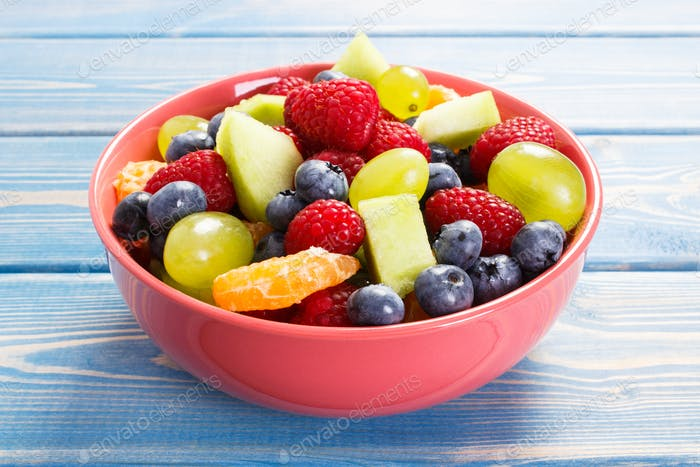 Fresh fruit salad in glass bowl, healthy nutrition concept