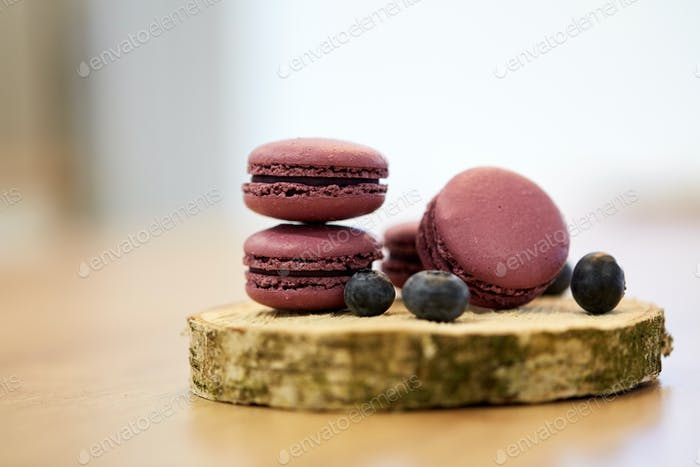 blueberry macarons on wooden stand