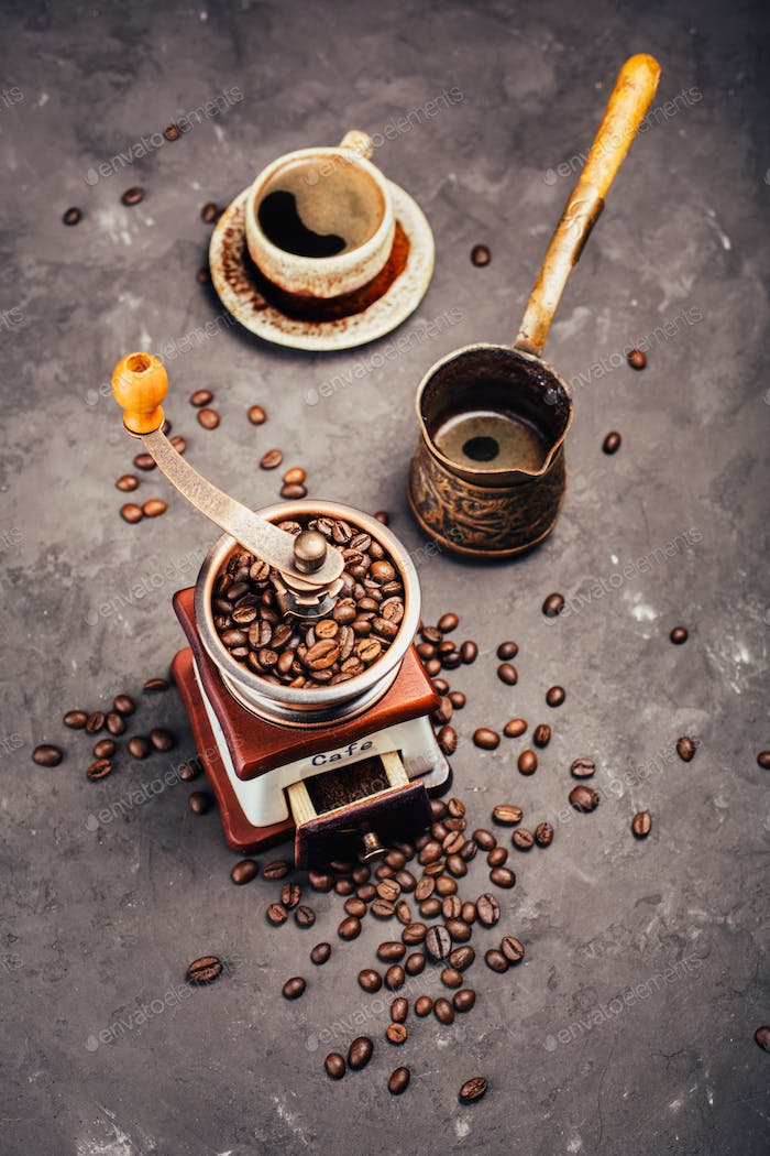 Grinder, cezve and coffee beans