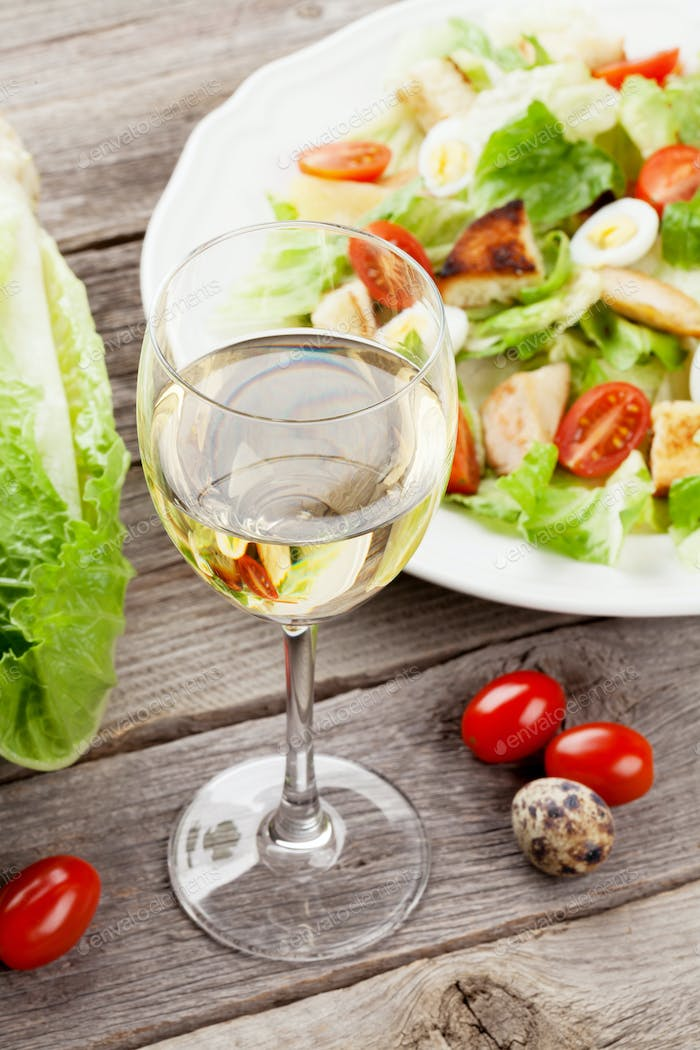 Fresh healthy salad and white wine