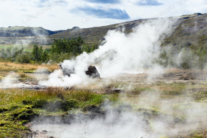 many geysers in Haukadalur valley in Iceland