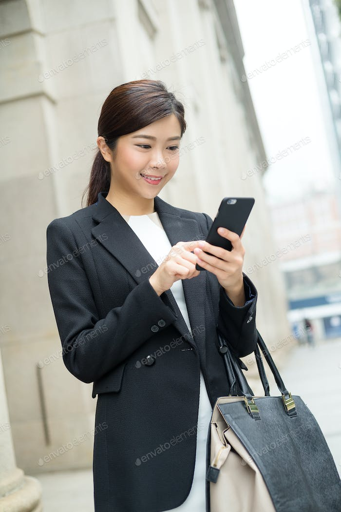 Business woman lawyer looking at mobile smartphone