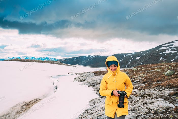 Aurlandsfjellet, Norway. Happy Young Woman Tourist Traveler Phot