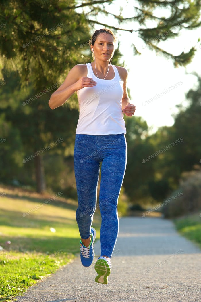 Active woman running in park
