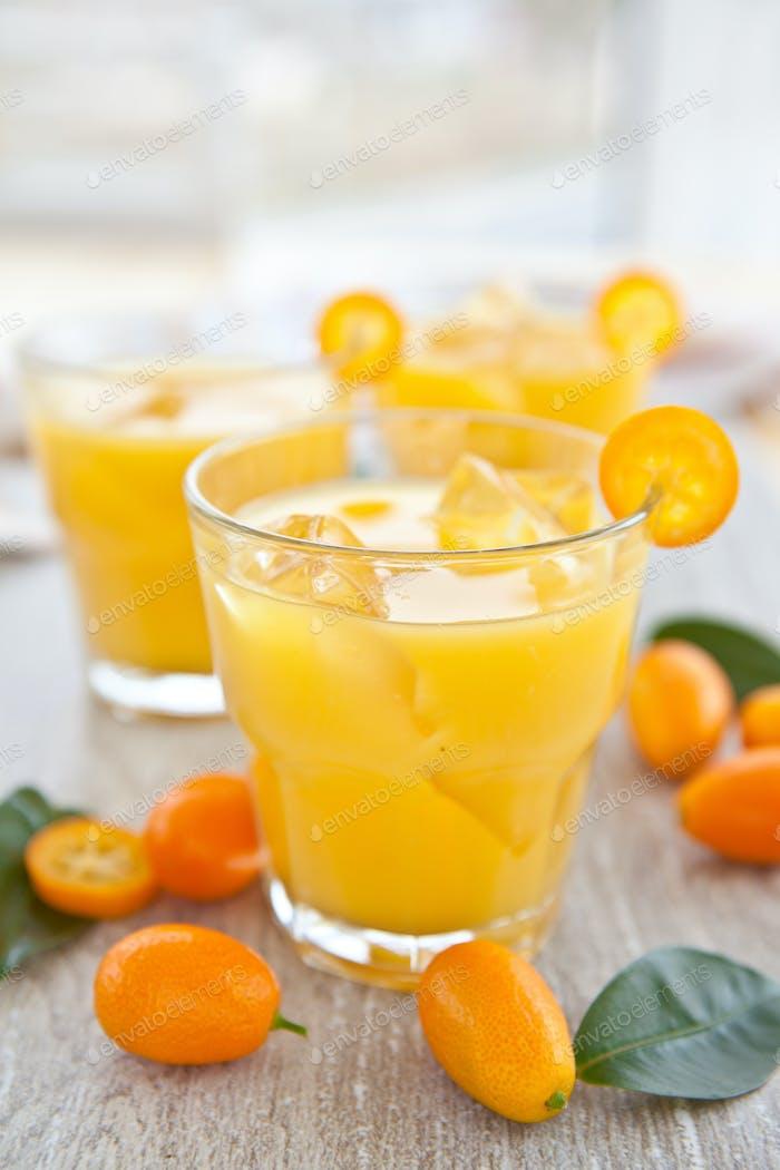 Fresh orange juice and kumquats