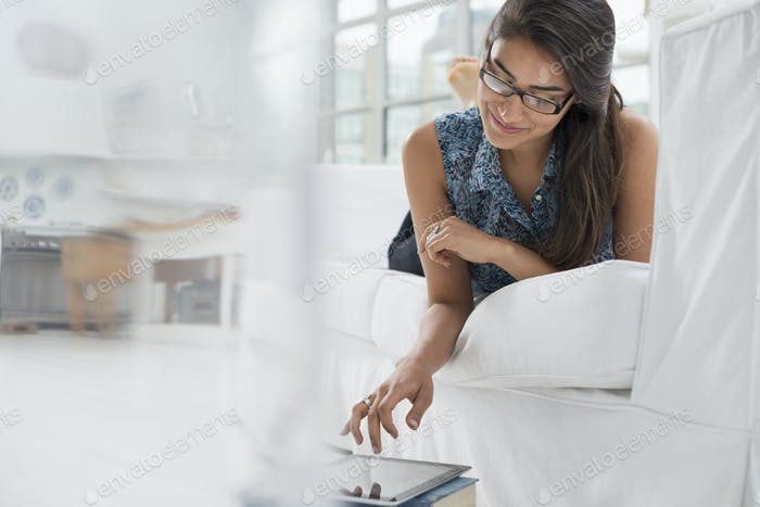One person sitting comfortably in a quiet office using a digital tablet