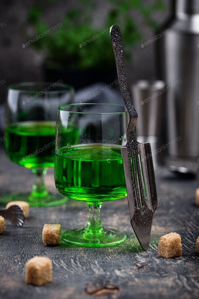 Glass of absinthe with cane sugar