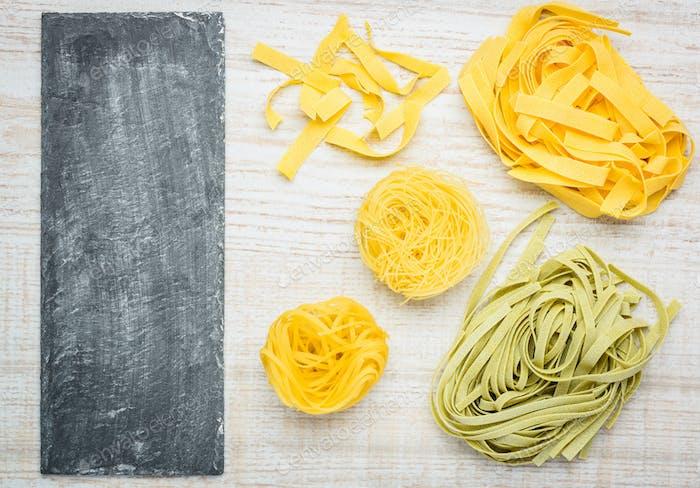 Tagliatelle Tagliolini Fettuccine Pasta and Copy Space