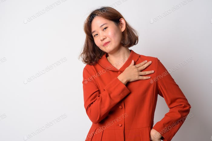 Portrait of proud Asian woman looking at camera