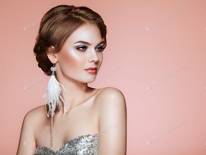 Beautiful Woman with Large Earrings Tassels