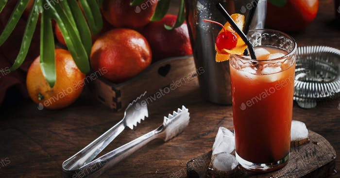 Summer refreshing low alcoholic cocktail with vodka, orange juice, bloody orange and ice