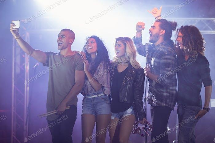 Cheerful musicians taking selfie