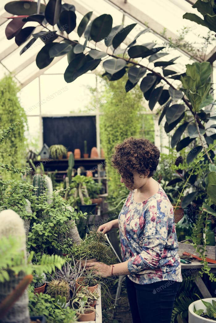 Woman working in a garden shop