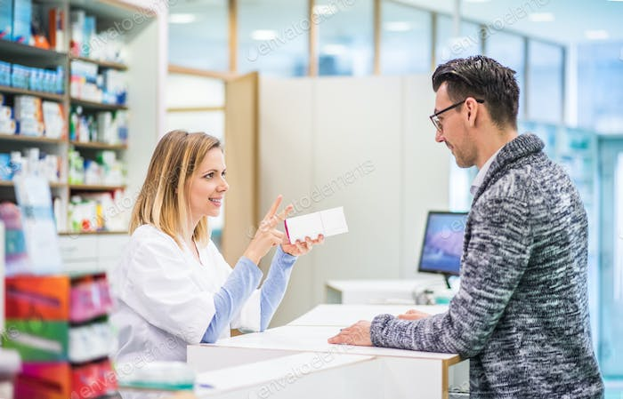 Female pharmacist serving a male customer.