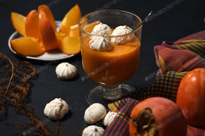 Dessert with persimmon fruit and meringue