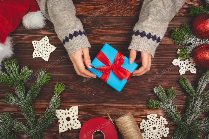 Christmas time. Process of packing gifts for holidays