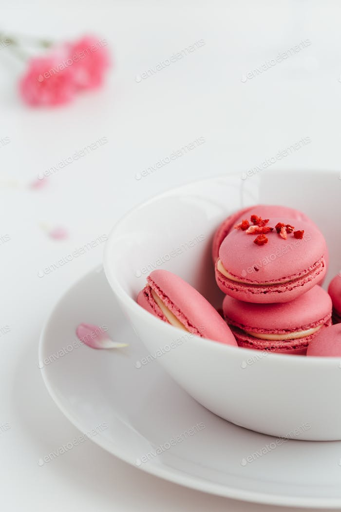 Strawberry Macarons in White Bowl on White Background