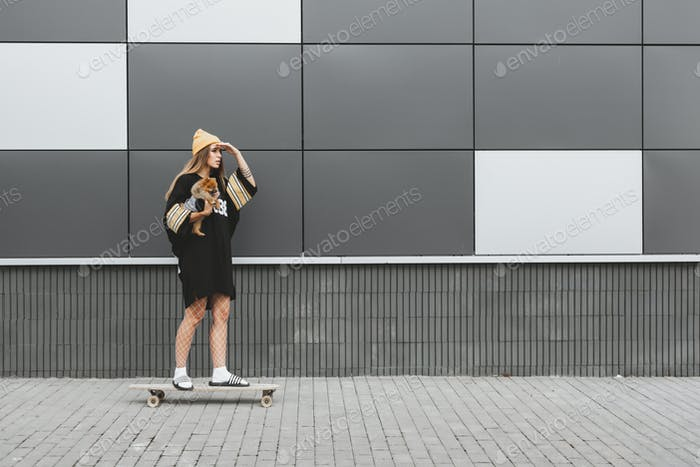 Girl with dog on longboard