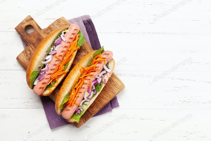 Hot dog with vegetables and lettuce