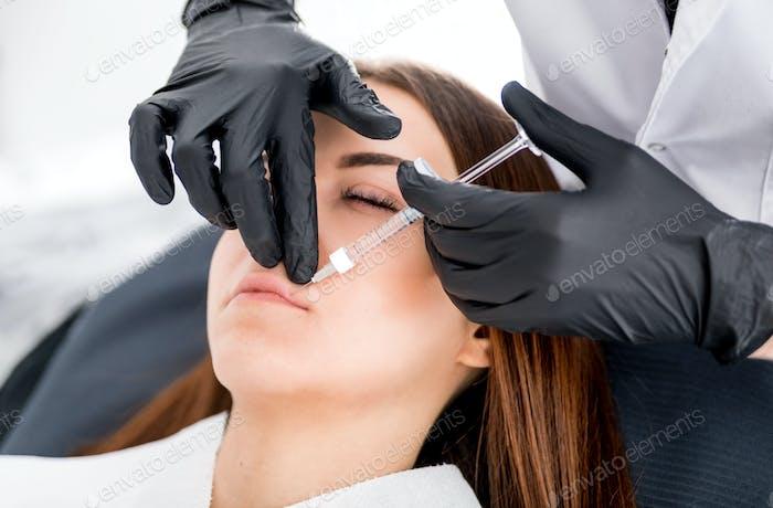 Enlarging lips at cosmetic clinic