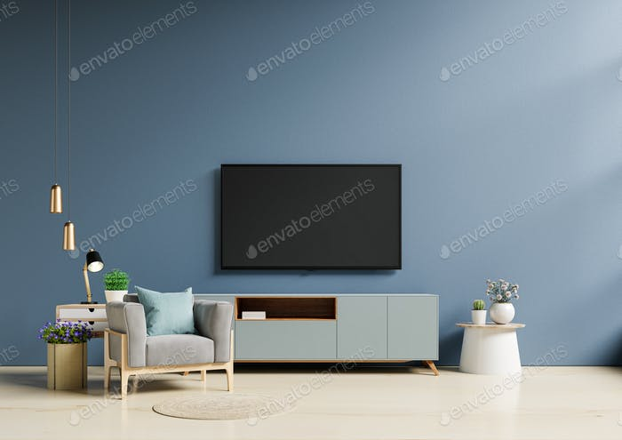 TV in modern living room with armchair have empty dark blue wall.