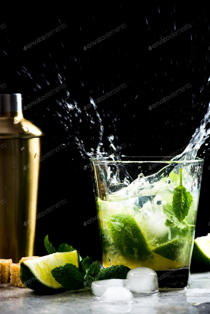 Dynamic high speed Mojito coctail splash on bar