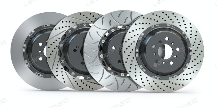 Different types of brake disks. Drilled and slotted brake disks in a row.
