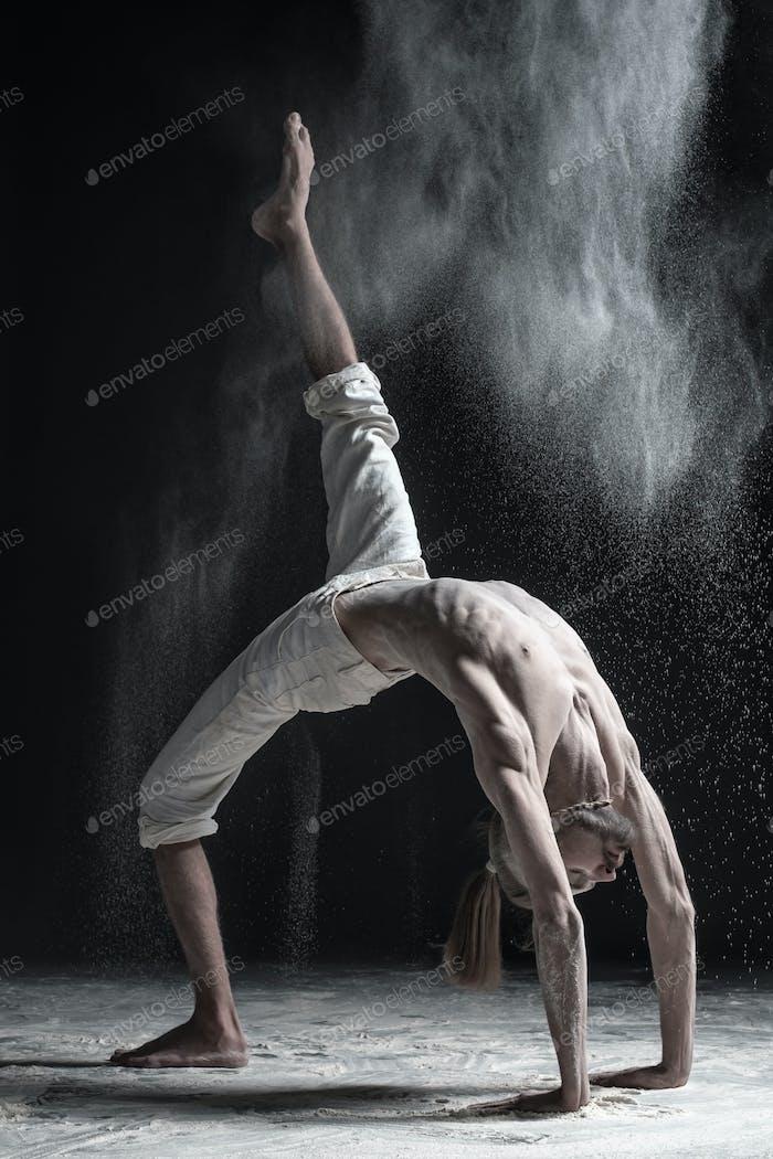young man doing yoga. Urdhva Dhanurasana.