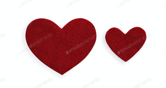Dark red felt hearts isolated on white background, valentine day