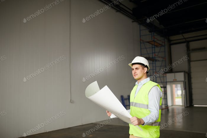 Engineer examining the plan