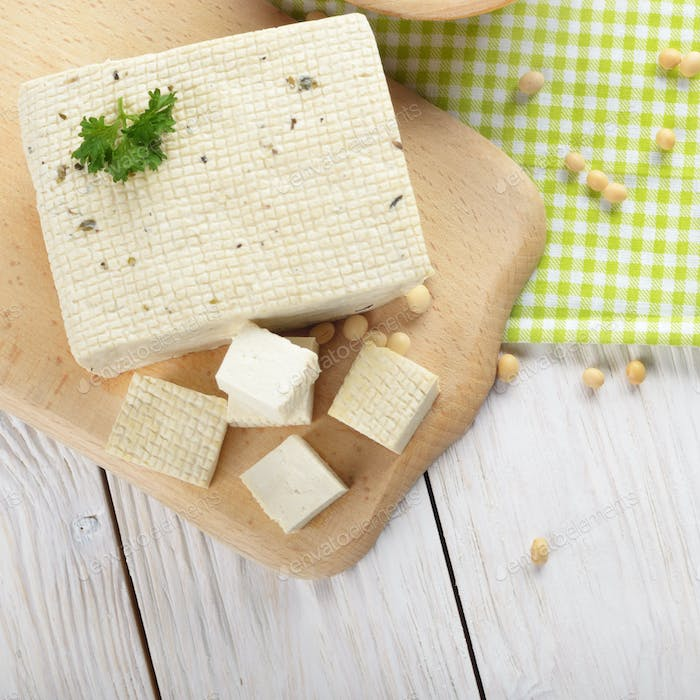 Flat lay view at Soy Bean curd tofu on cutting board Non-dairy a