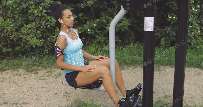 Sportswoman in street gym