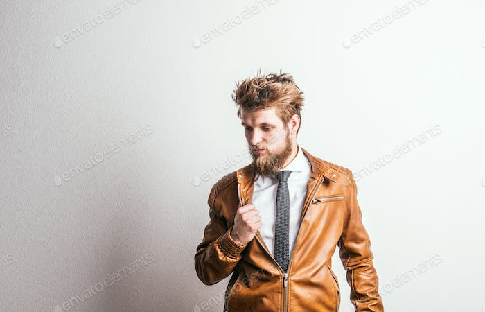 Portrait of a young hipster man in a studio on a white background. Copy space.