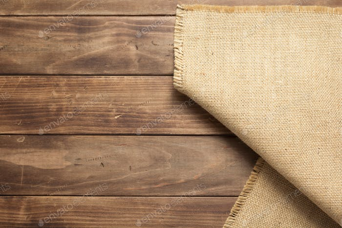 burlap hessian sacking on wooden background table