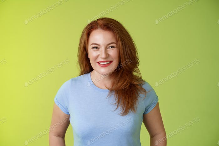 Cheerful kind happy redhead middle-aged mother look caring delighted smiling broadly gaze admiration
