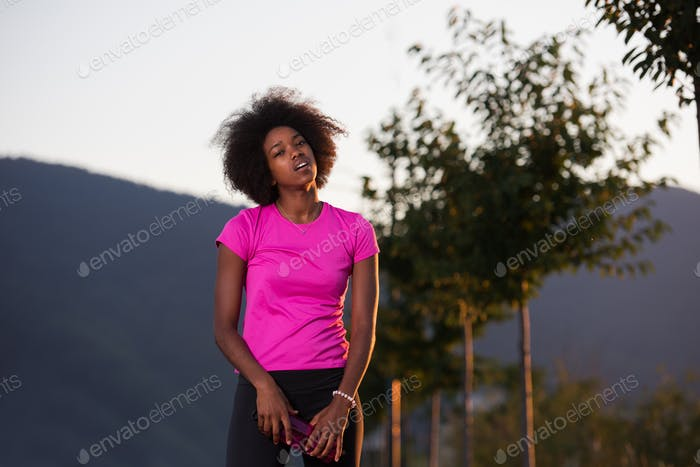 Portrait of a young african american woman running outdoors