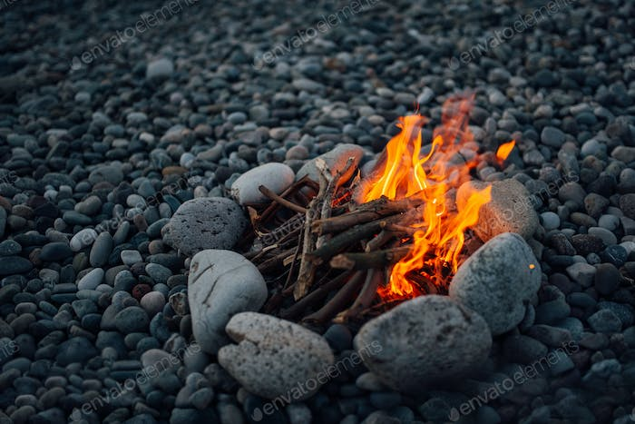 fire overlaid with stones burning