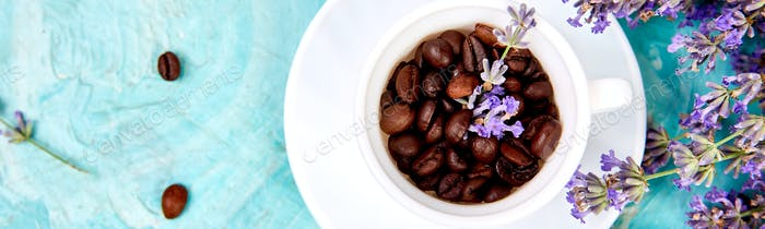 Banner with Grain Coffee in cups and lavender flower on blue background from above.