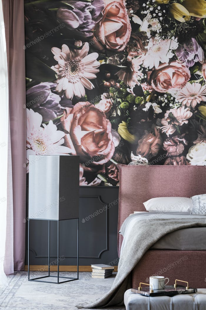 Flowers print on the wall in feminine bedroom interior with grey