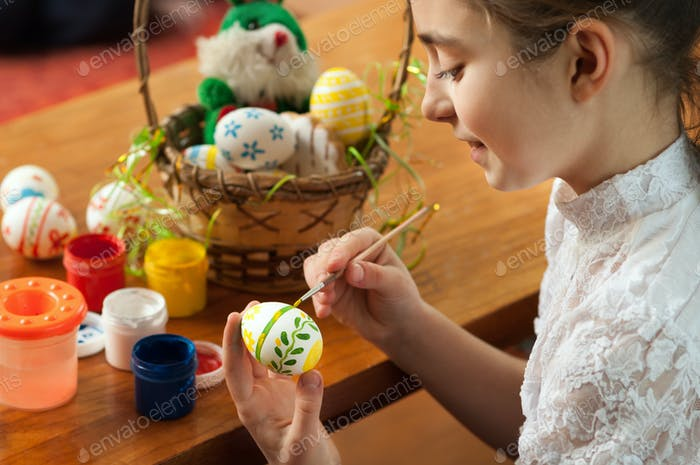 beautiful girl colored Easter eggs