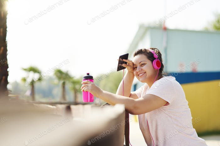 Woman running with big smile on the face