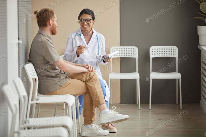 Nurse with patient at the corridor