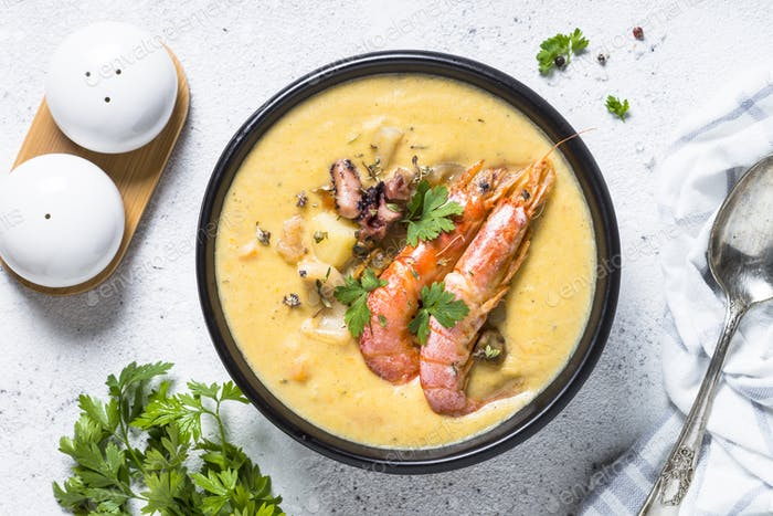 Chowder soup with seafood and prawn shrimps