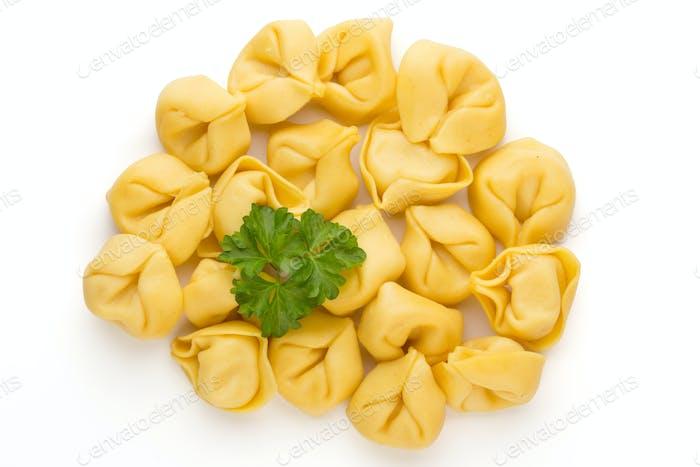 Raw homemade pasta,tortellini with herbs.