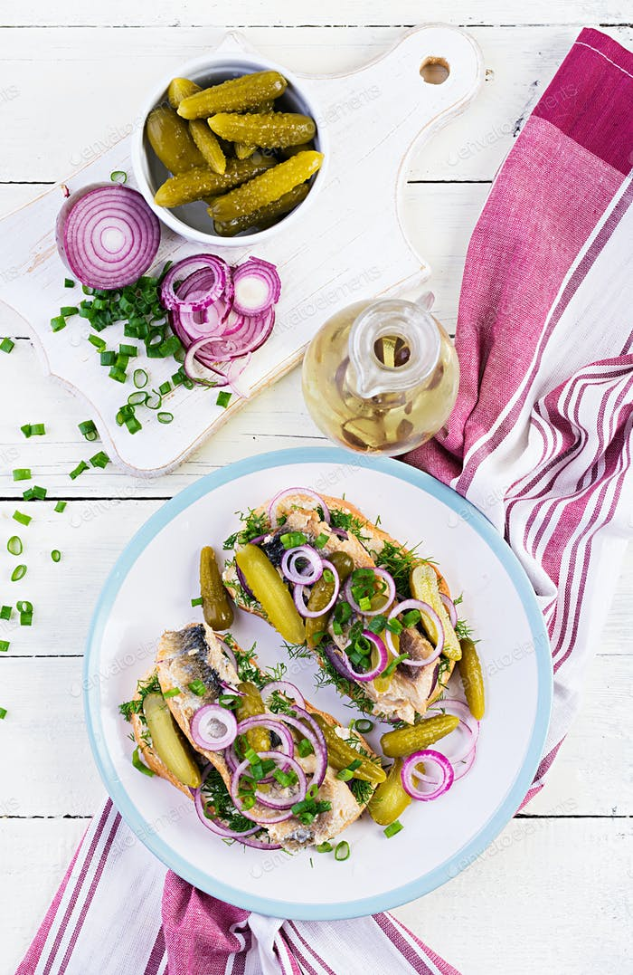 Traditional Dutch sandwich with herring and pickles cucumbers on