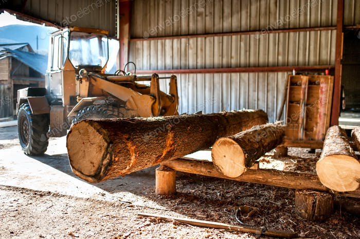 industrial log loader operating at industrial wood production factory
