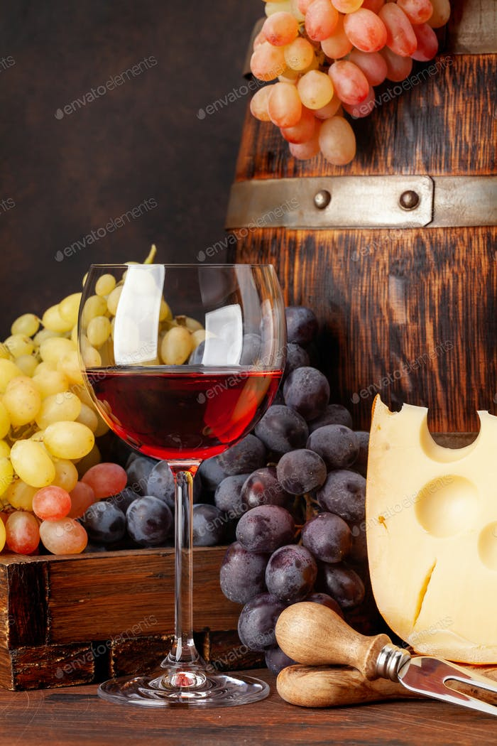 Grapes, cheese, glass of wine