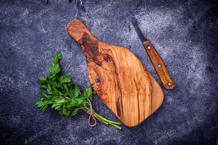 Fresh parsley, knife  and cutting board