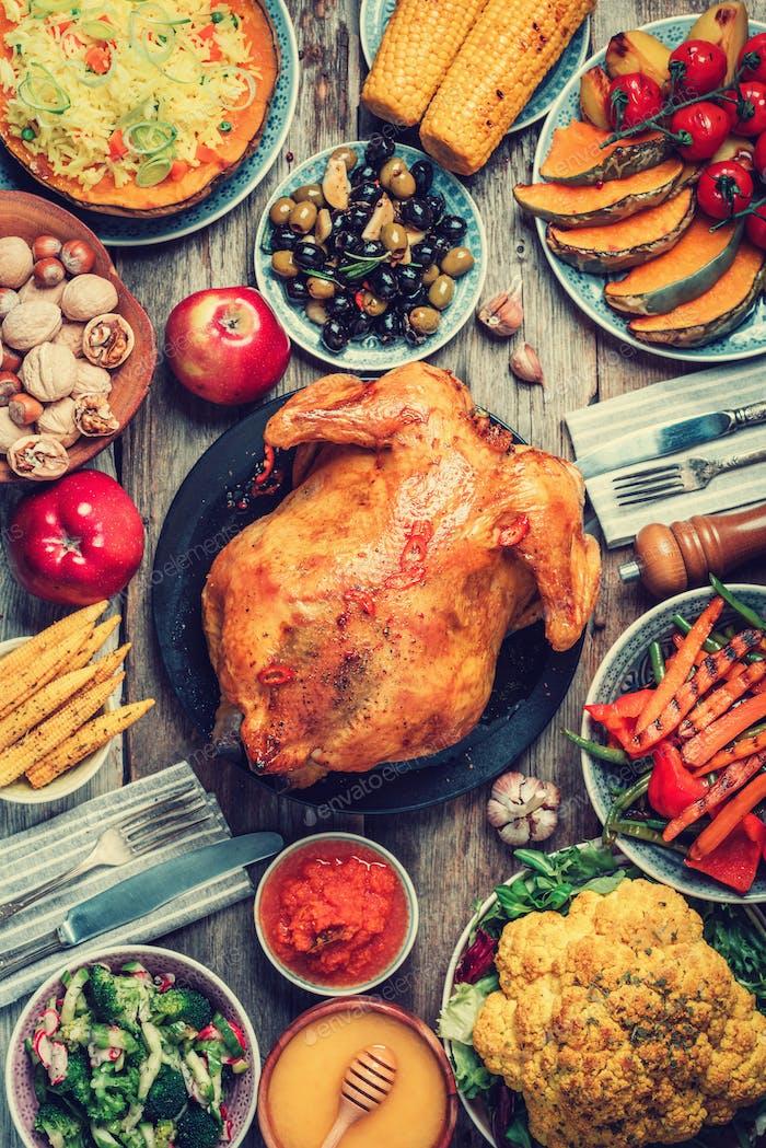 Thanksgiving dinner cooking preparation. Traditional dishes: chicken, pumpkin, corn, vegetables