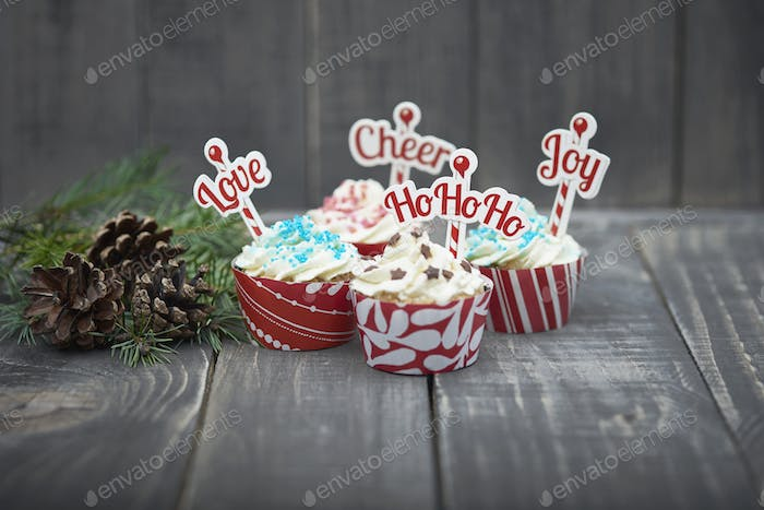 Delicious christmas muffins on the wood